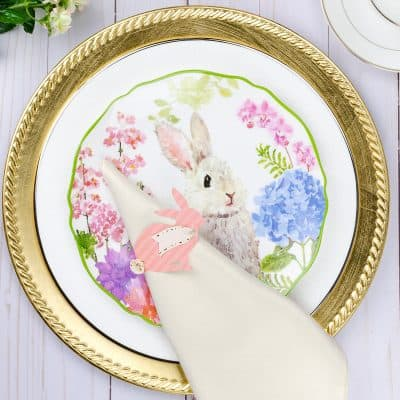 Bunny napkin ring and ivory napkin on bunny plate and gold charger for Easter tablescape
