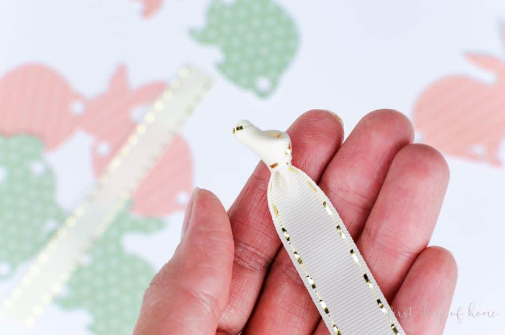 Knot on the end of ribbon for tail on DIY bunny napkin rings
