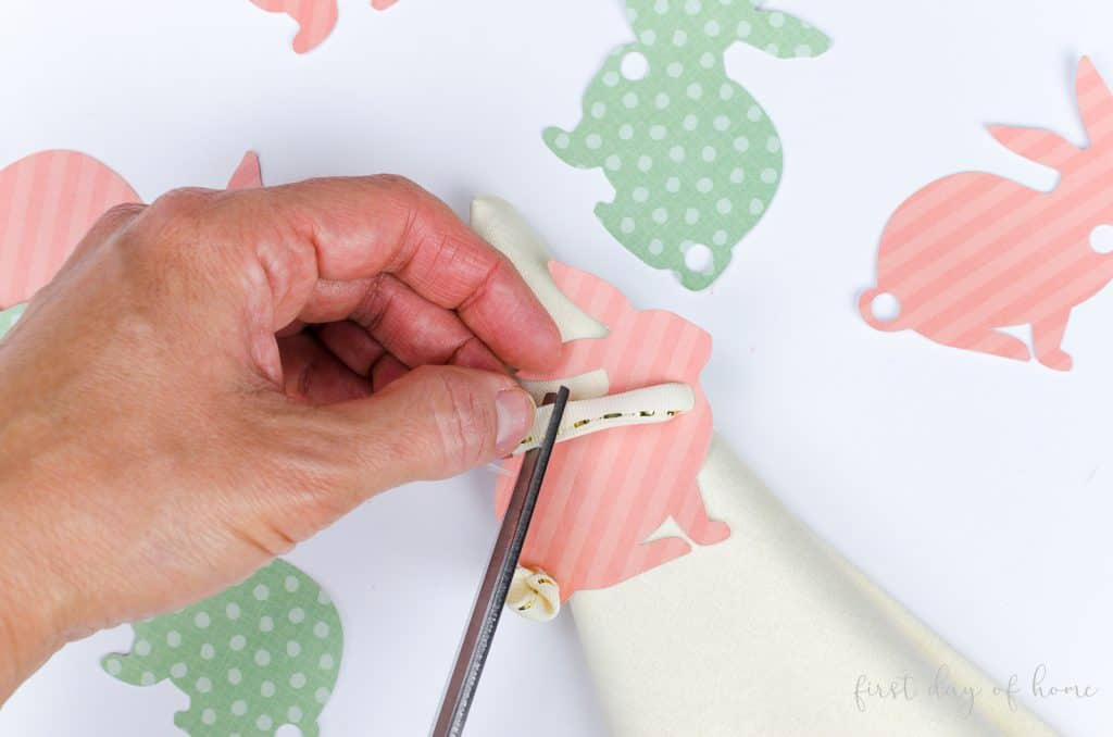 Cutting ribbon on Easter bunny napkin rings