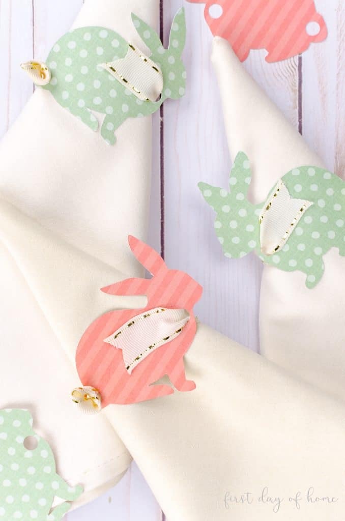 Pink and green bunny napkin rings using scrapbook paper and grosgrain ribbon for Easter tablescape