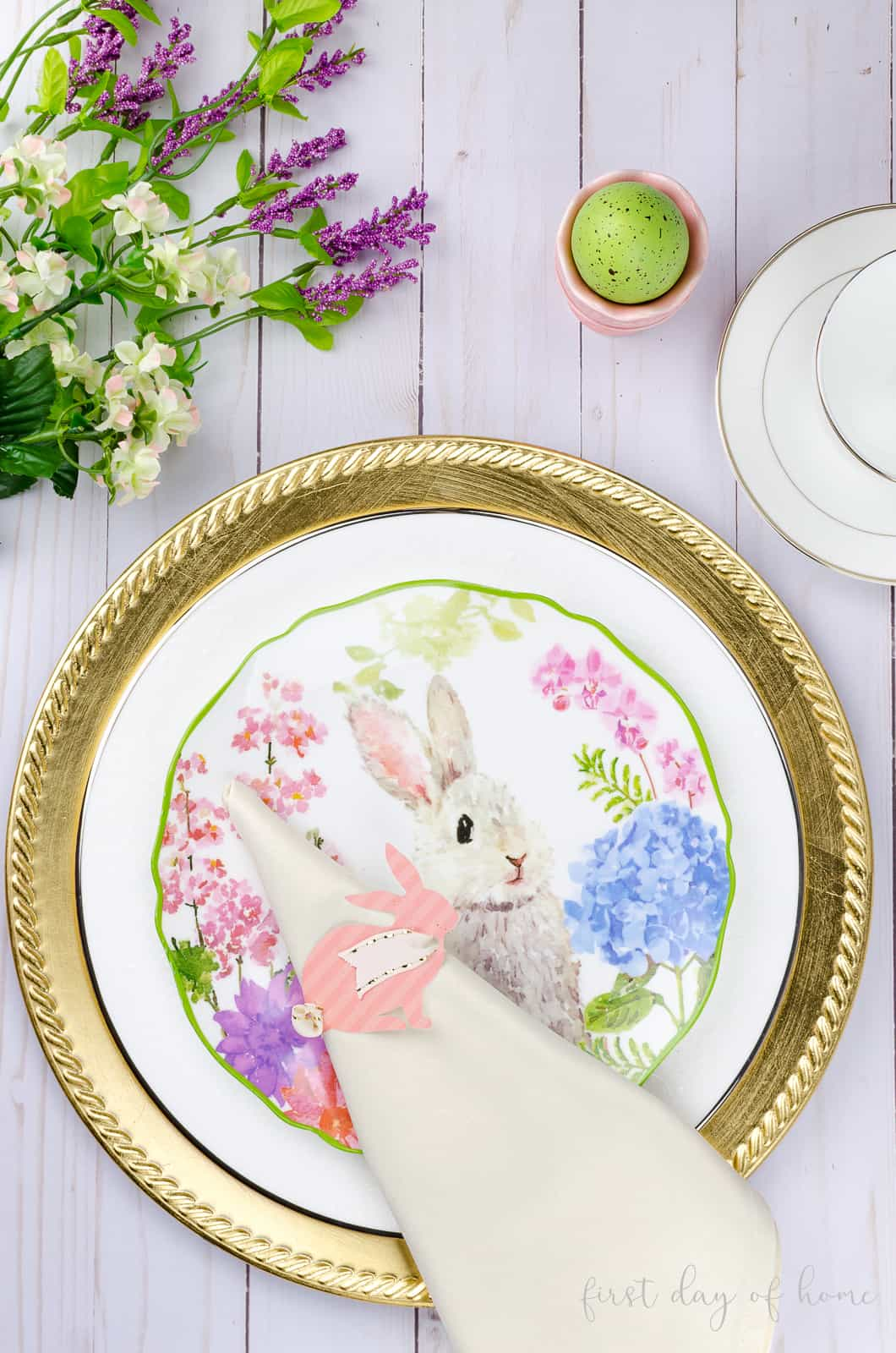 Bunny napkin rings set on Easter bunny plate and gold charger for Easter tablescape decor