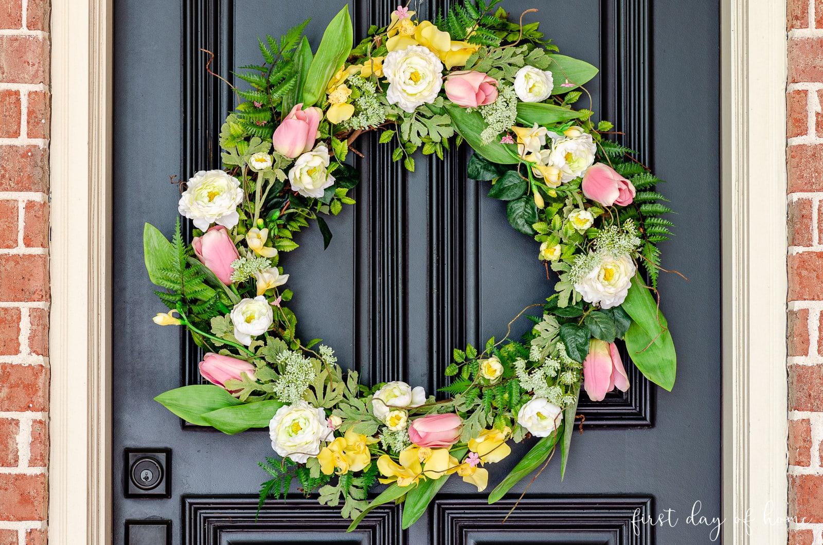 DIY floral wreath on black front door