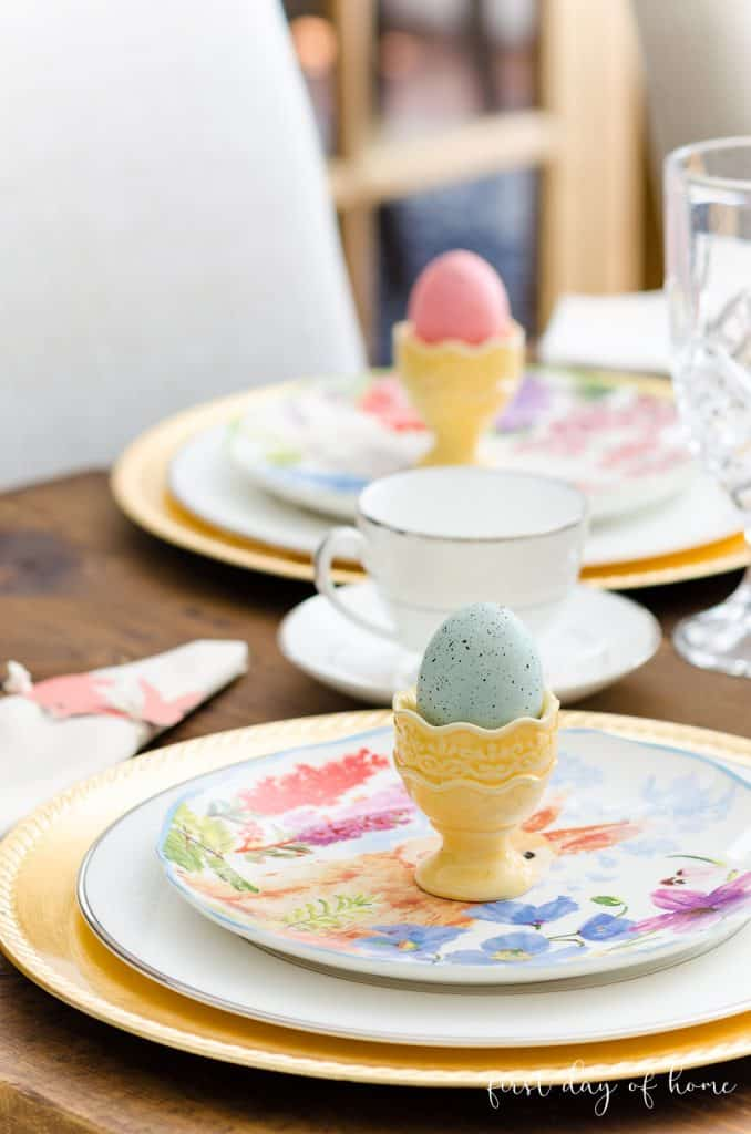 Easter egg cups sitting on layered plates