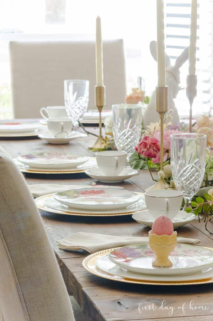 Easter tablescape with place settings in pastel color theme