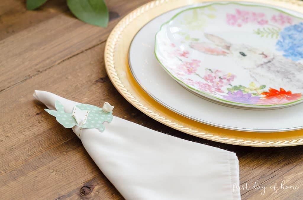 Green polka-dot DIY bunny napkin rings sitting on table