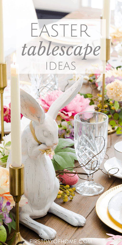 Easter table with floral garland, Easter eggs, candles and bunny plate place settings