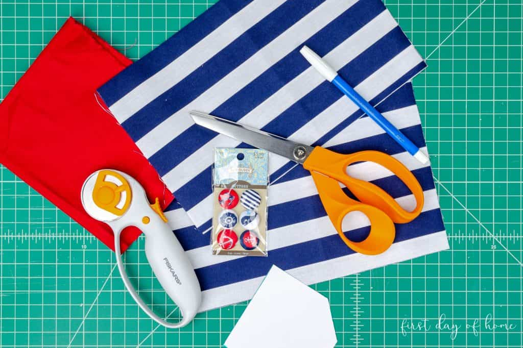 Sewing supplies for tooth fairy pillow tutorial, including fabric, scissors, thread, and buttons