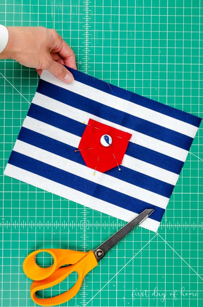 Attaching red pocket to blue and white tooth fairy pillow sewing project