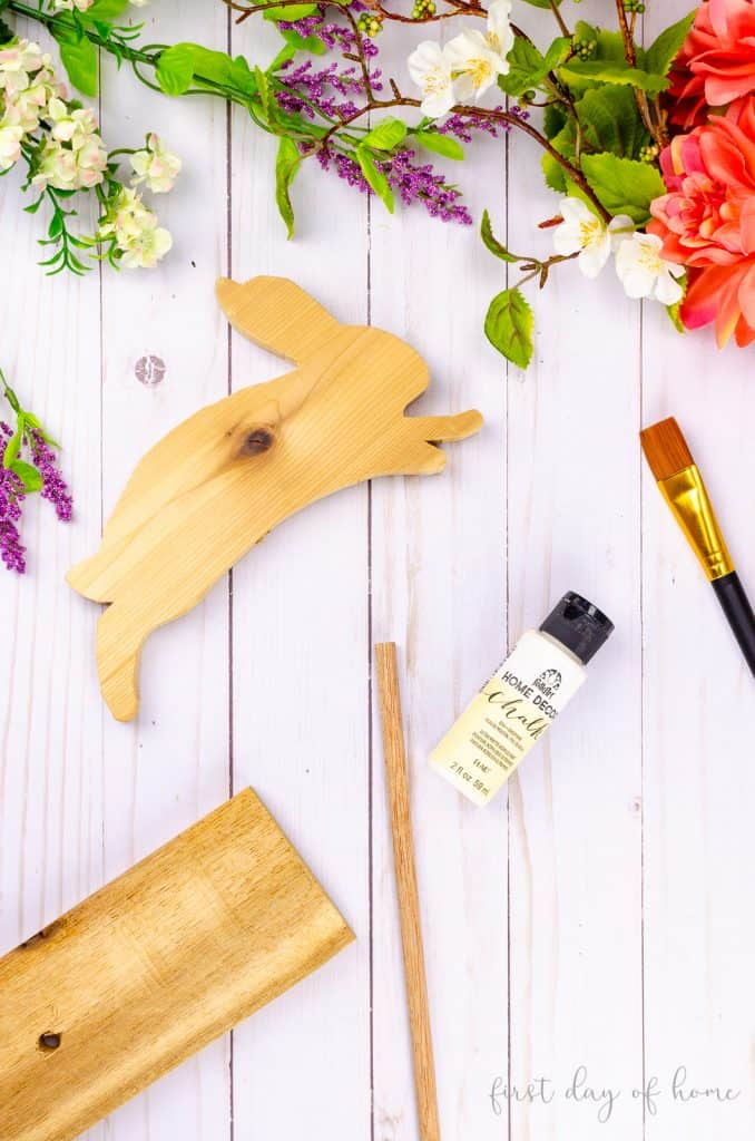DIY wooden bunny supplies, including scrap wood and chalk paint