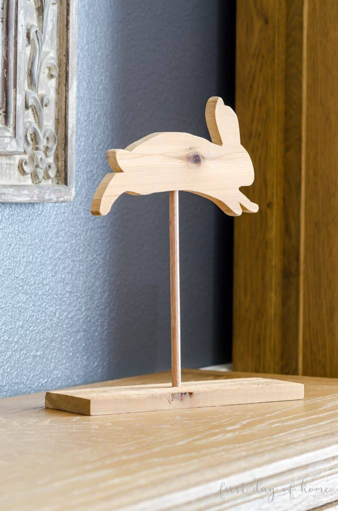 Unfinished wooden bunny on stand