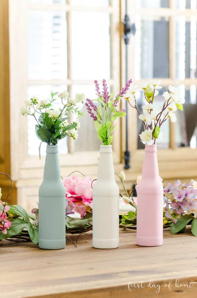 Trio of blue, white and pink painted bottles using chalk paint