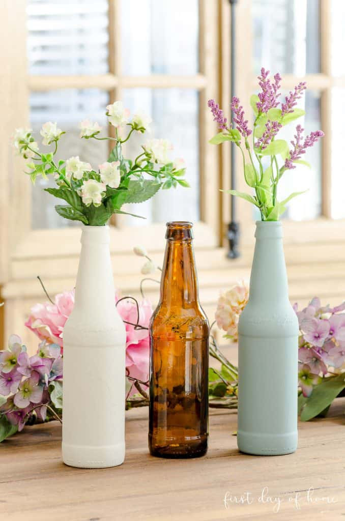 Trio of painted bottles upcycled using chalk paint