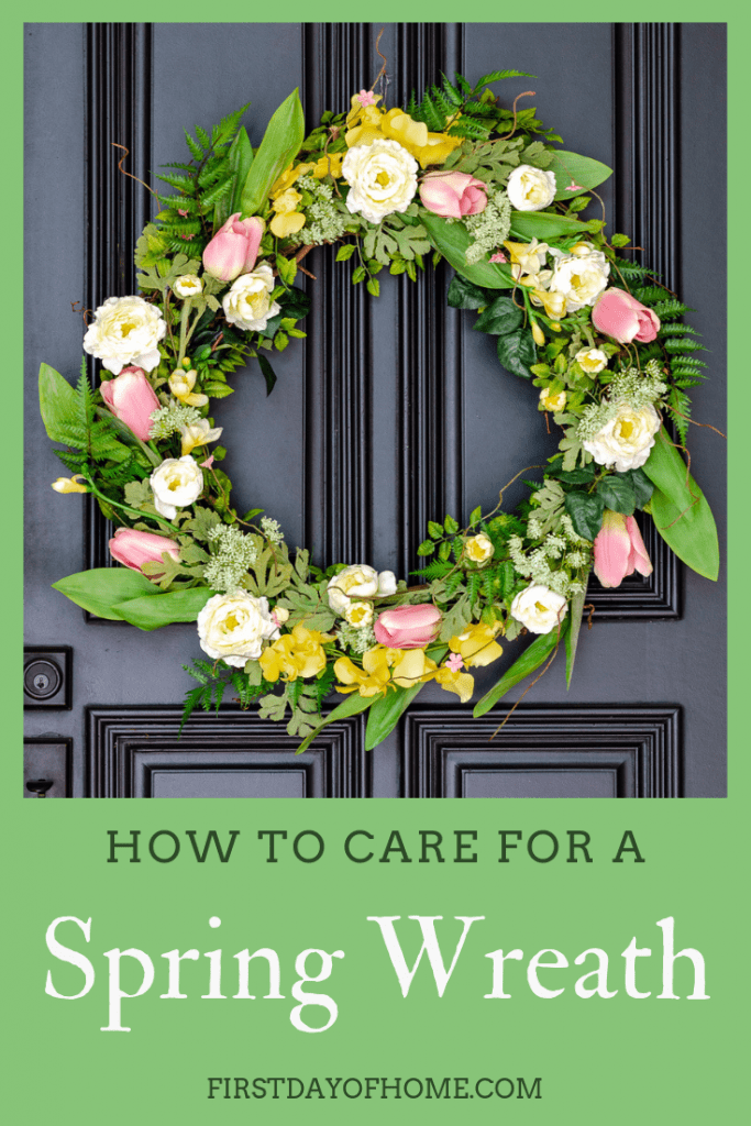 DIY spring wreath hanging on black front door