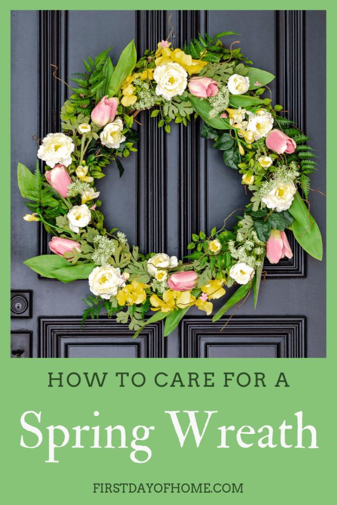 DIY spring wreath hanging on black front door