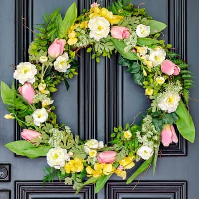 DIY spring wreath for front door with ranunculus, orchids, tulips, freesia and greenery