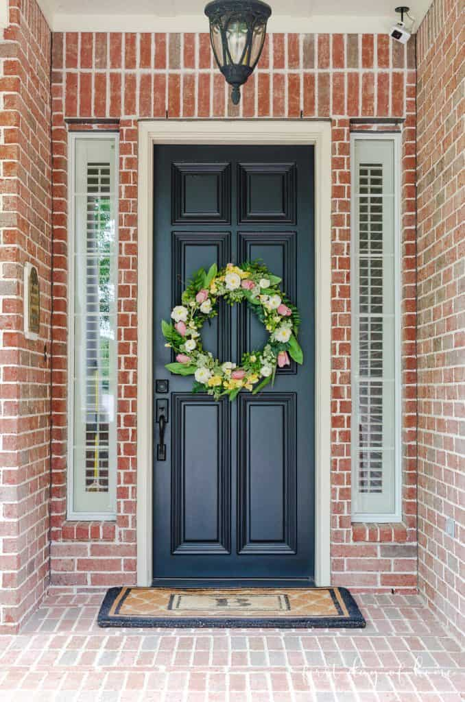 Front porch with DIY spring wreath on front door