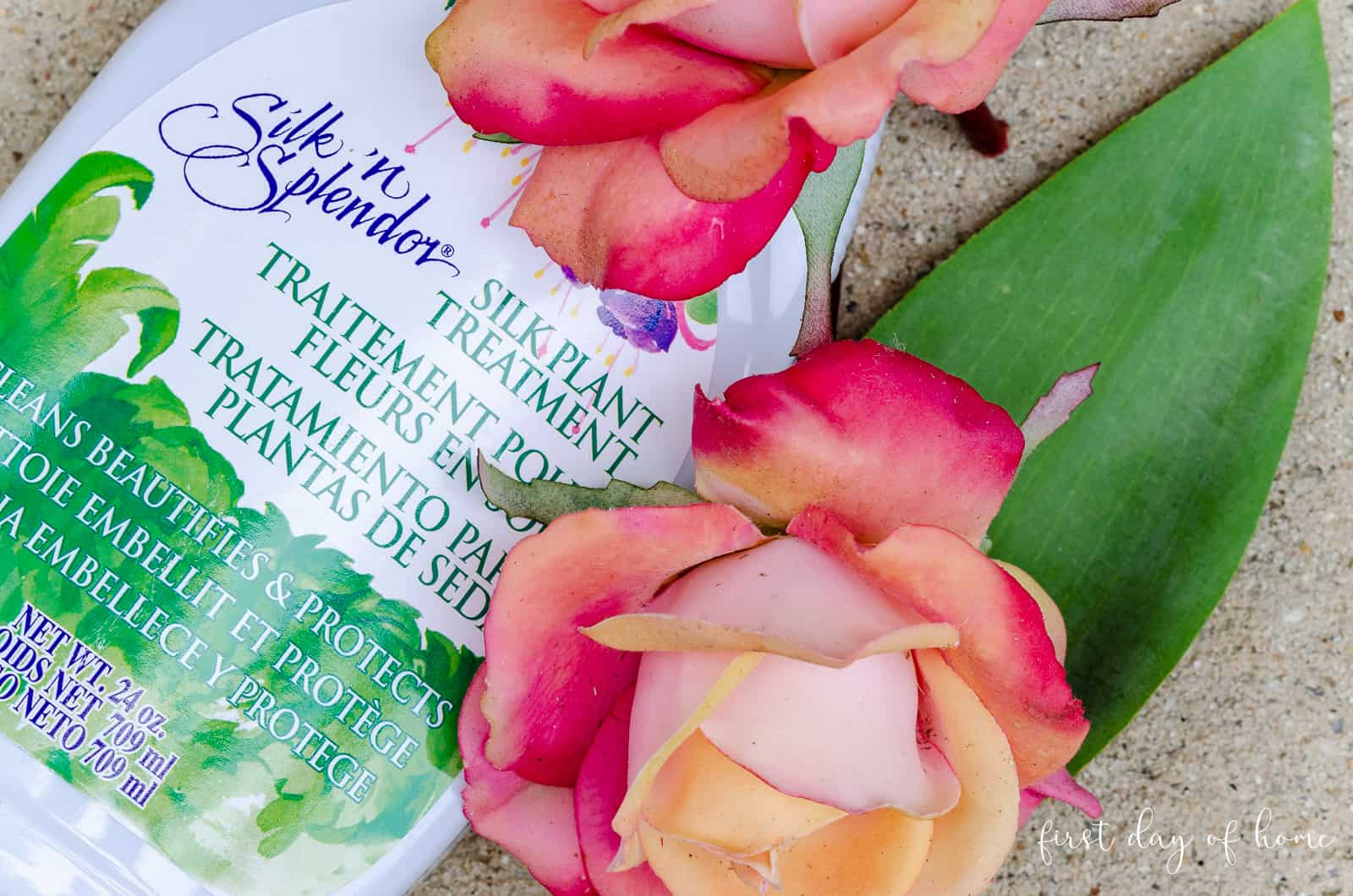 Silk flower cleaning spray with faux roses that have gathered dust