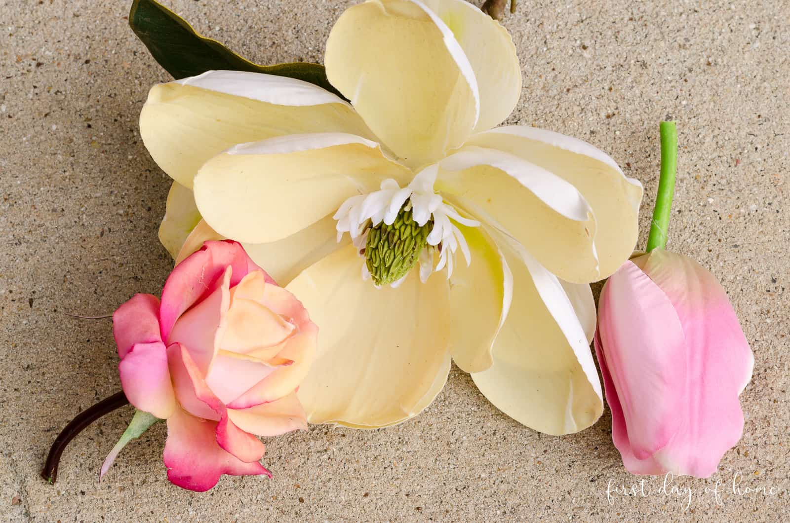 Artificial magnolia, rose and tulip flowers used for front door spring wreath