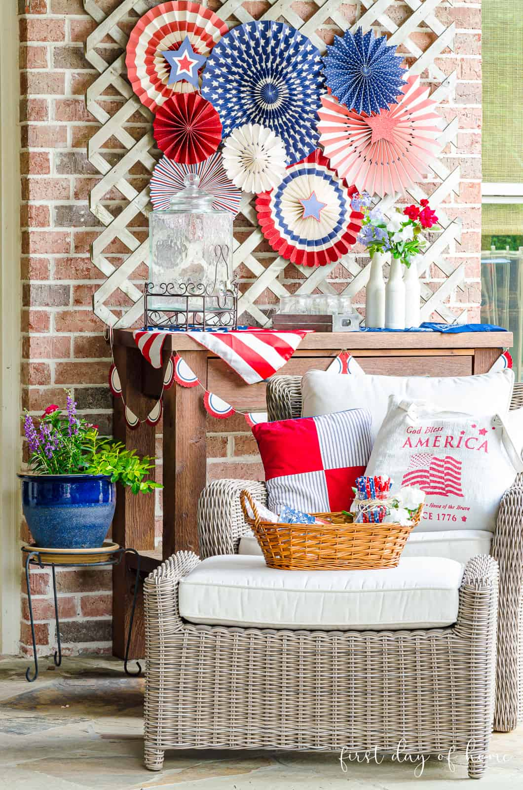 4th of July decorated patio with patriotic fans and decor in red, white and blue