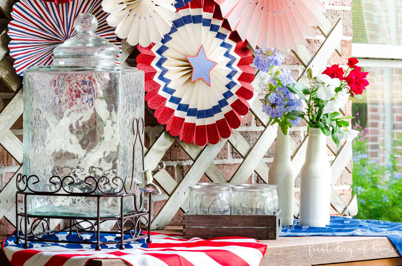 July 4th decorating ideas with paper fans and painted bottle vases