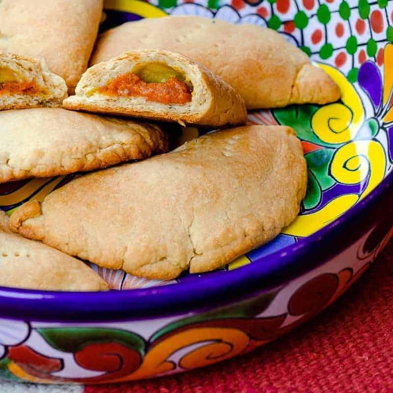 Baked pumpkin empanadas in Mexican dishware