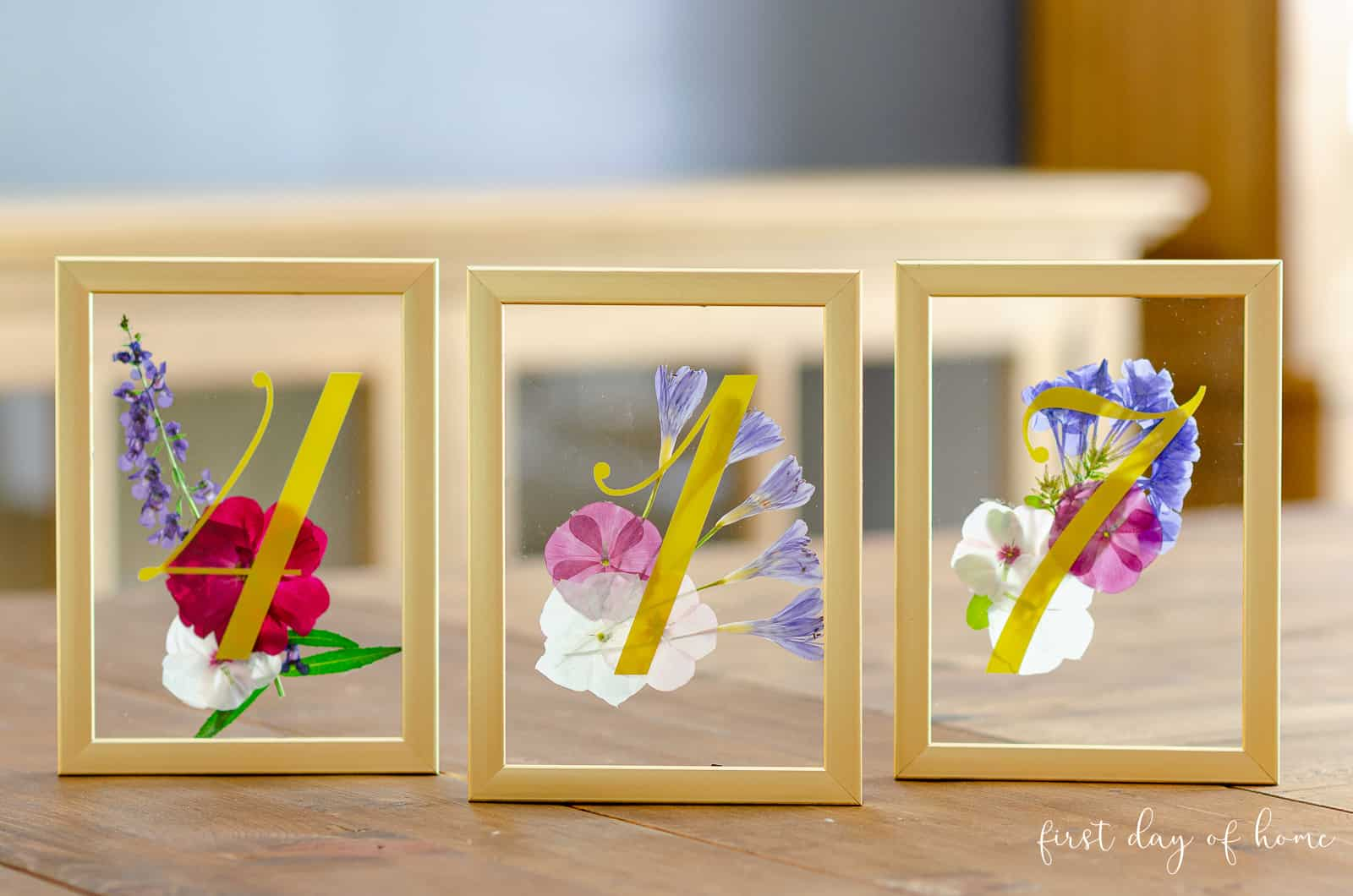 Wedding table number ideas using pressed flowers and gold frames