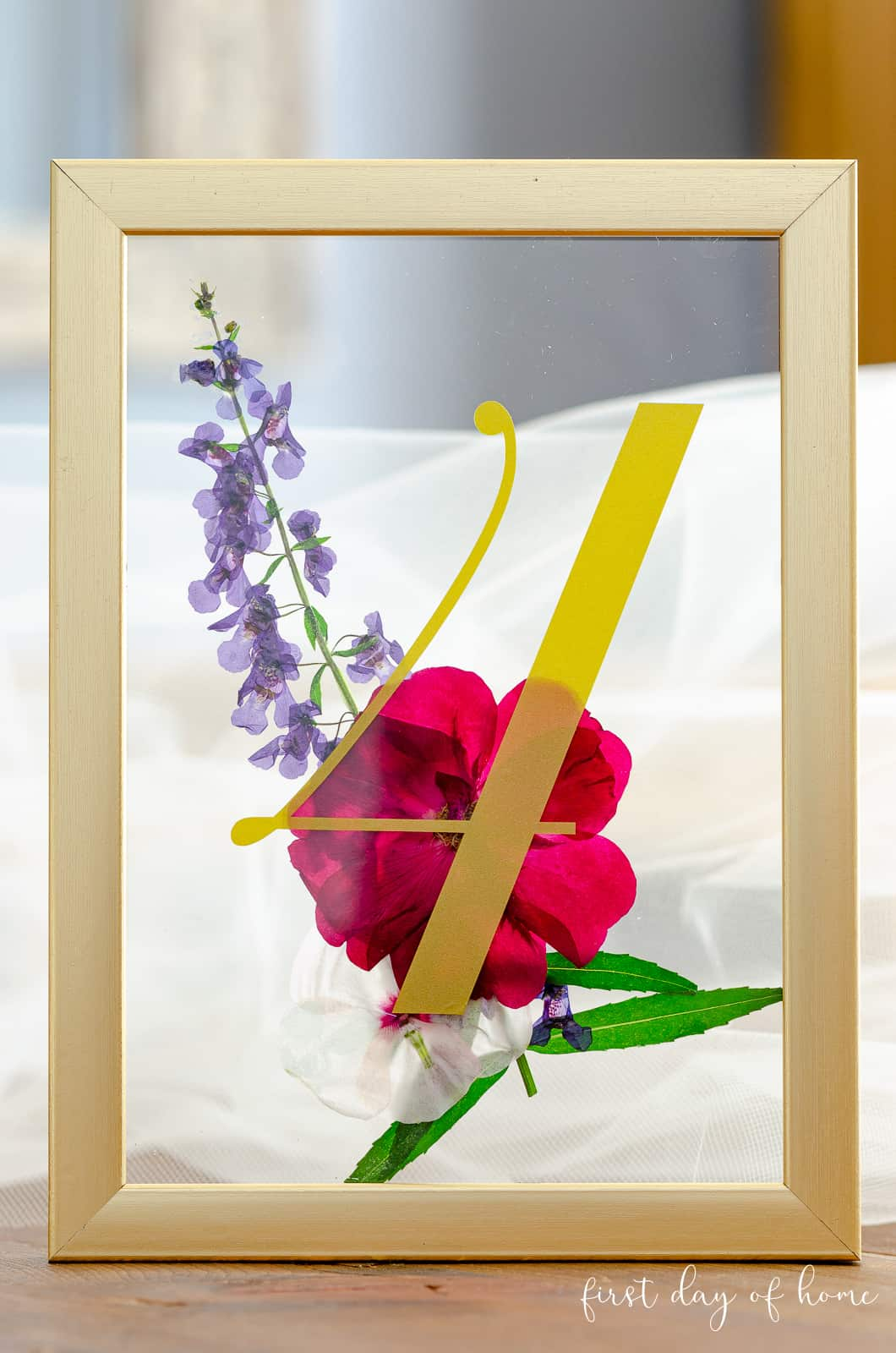 Wedding table number holders with pressed flowers