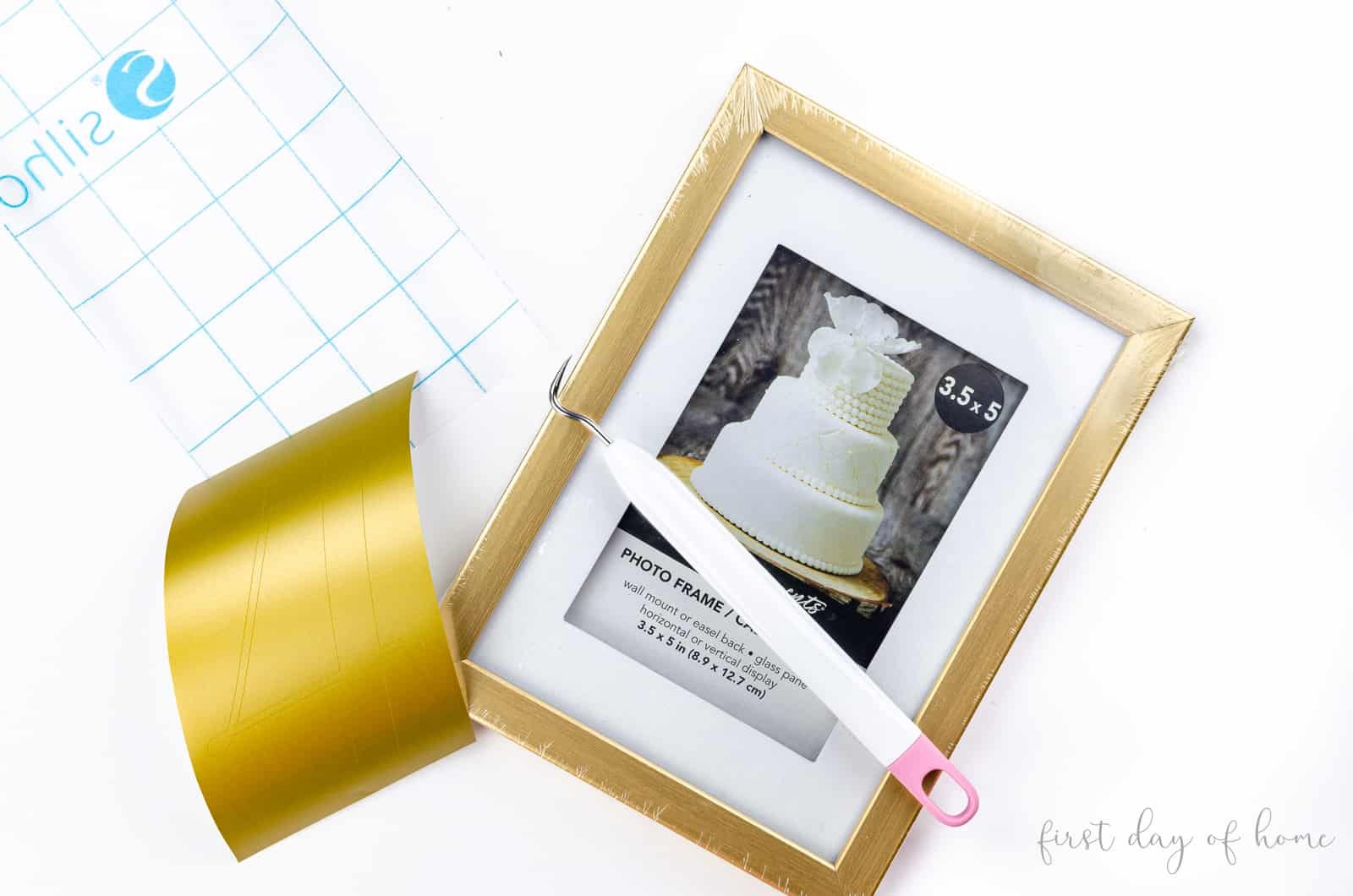 Supplies for gold wedding table number holders include removable matte vinyl, gold frames and transfer tape
