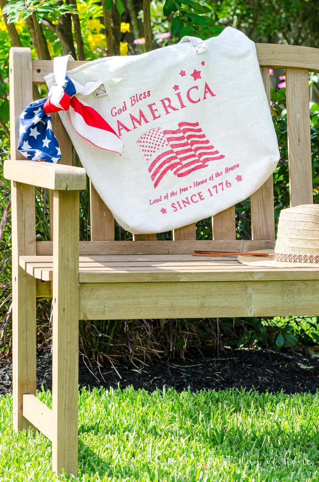 Hand painted canvas bag with patriotic stencil on bench