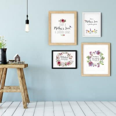 Mother's Day free printables in floral watercolor designs with quotes hanging on wall