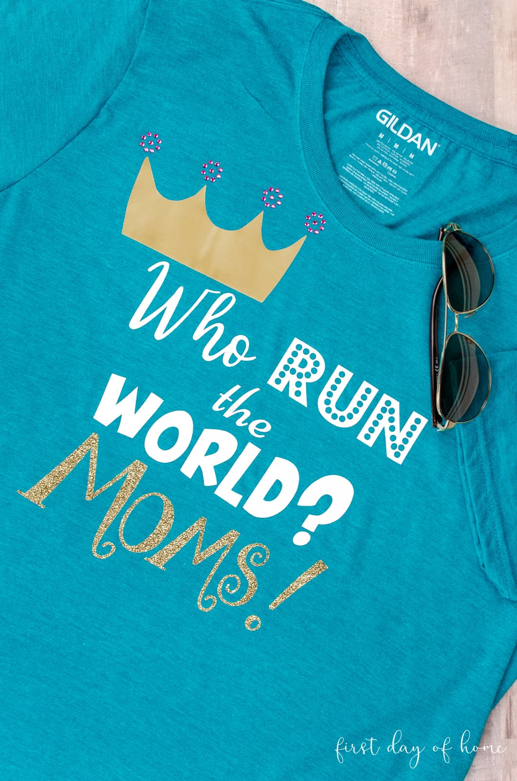 "T-shirt design for Mother's Day with phrase ""Who Run the World? Moms!"""