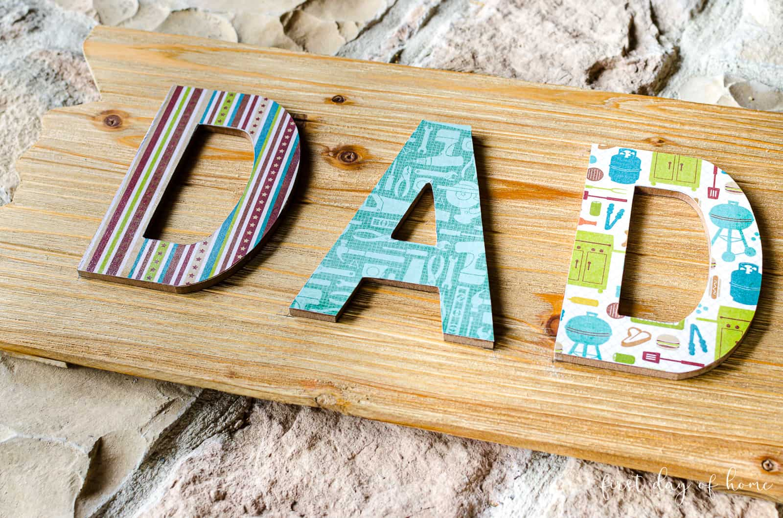 "Finished decoupage wood sign with ""DAD"" letters"