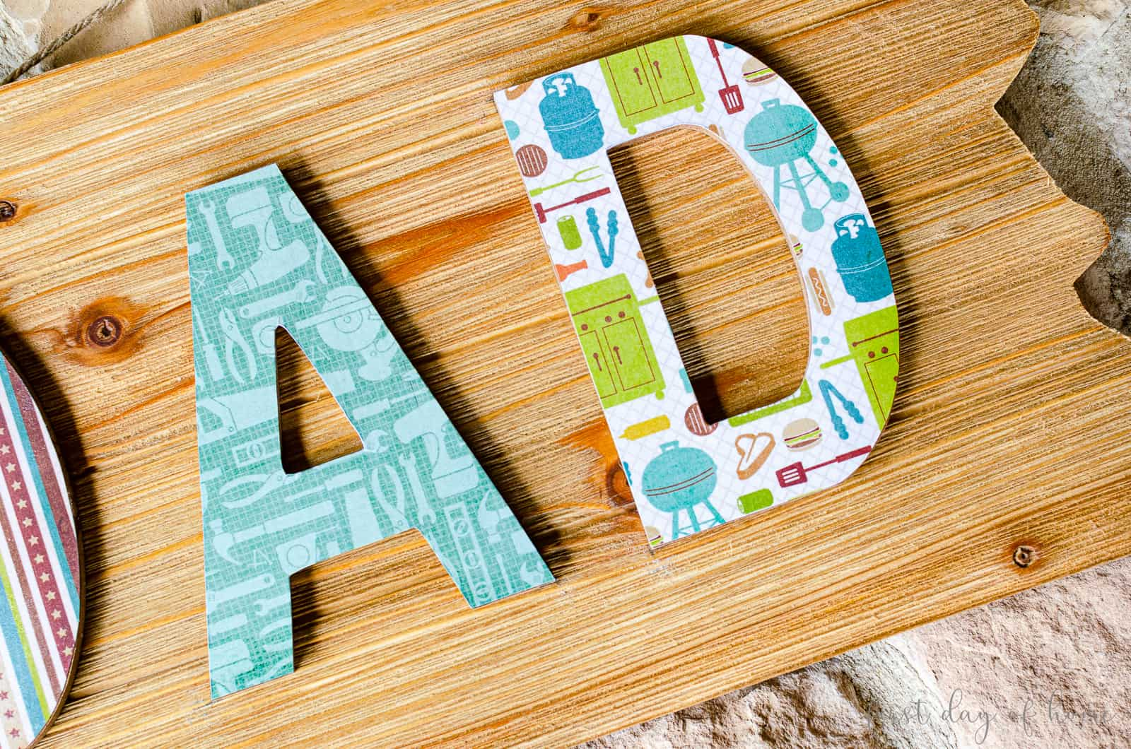 "Decoupage DIY project for Father's Day with ""DAD"" letters on it"