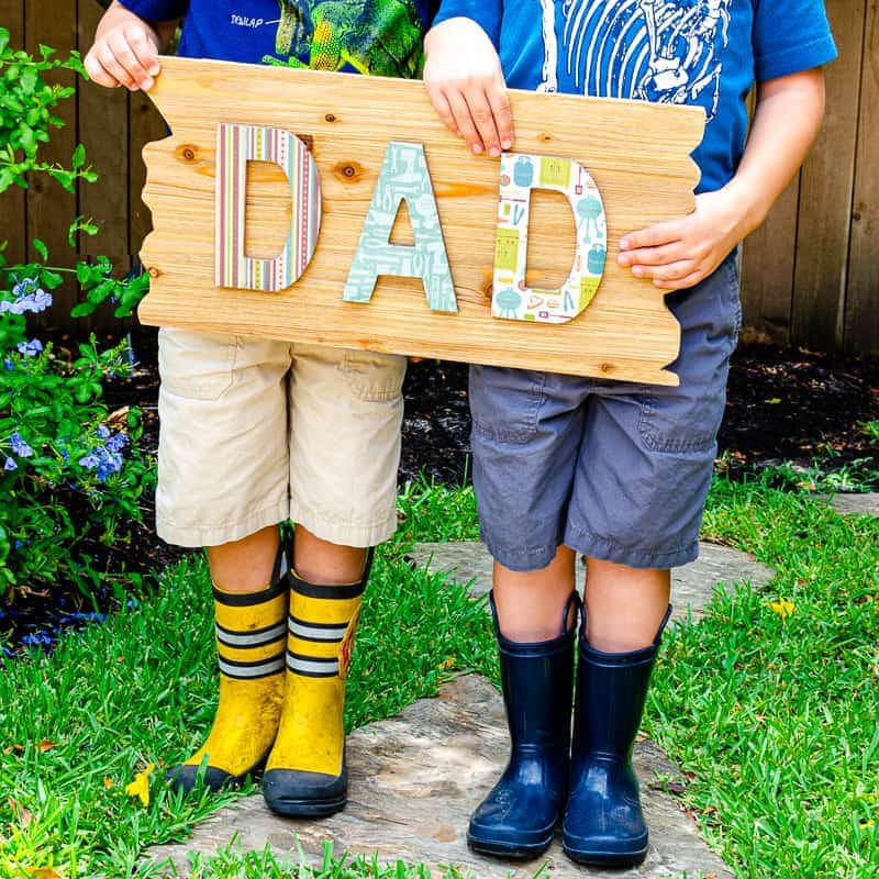 "Decoupage wood signs tutorial with ""Dad"" DIY decoupage sign on wooden background"