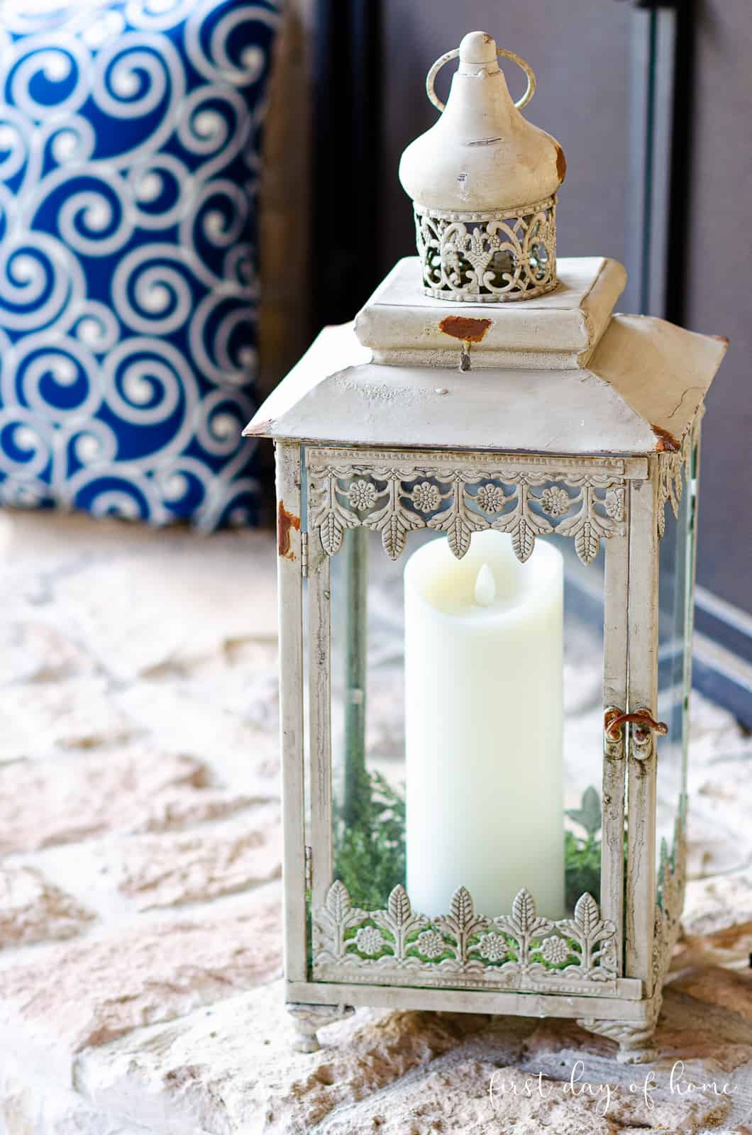 Lantern decorating ideas with blue pillow accent or greenery for outdoor decor