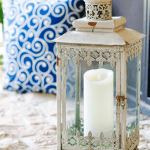 Moroccan lantern style on outdoor fireplace mantel