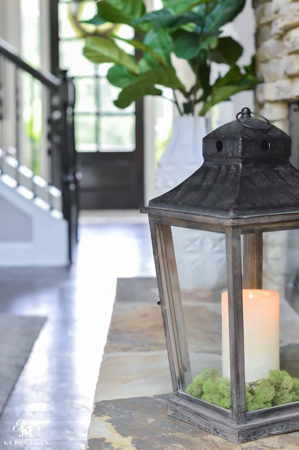 Lantern decor on hearth from Kelley Nan