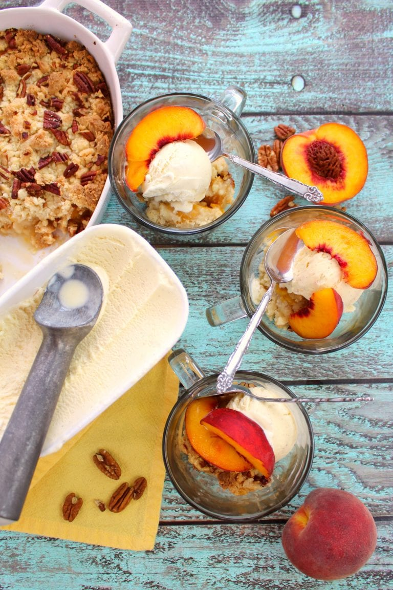 Cake mix peach cobbler in bowls with peaches and ice cream - by Delightful E Made