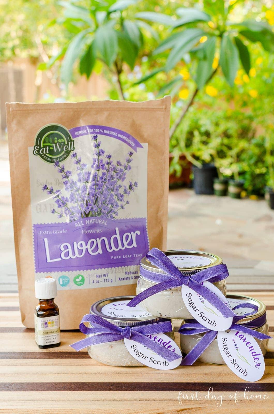 DIY lavender sugar scrub recipe supplies-lavender buds, lavender essential oil and mason jars with decorative printable tags