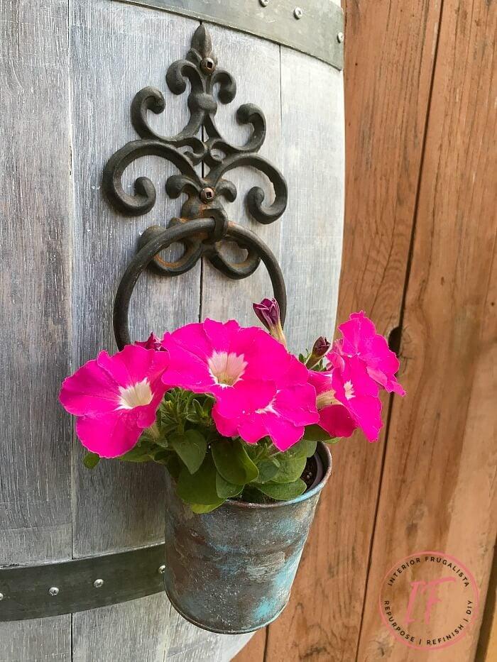 Barrel stave decorated as garden yard art