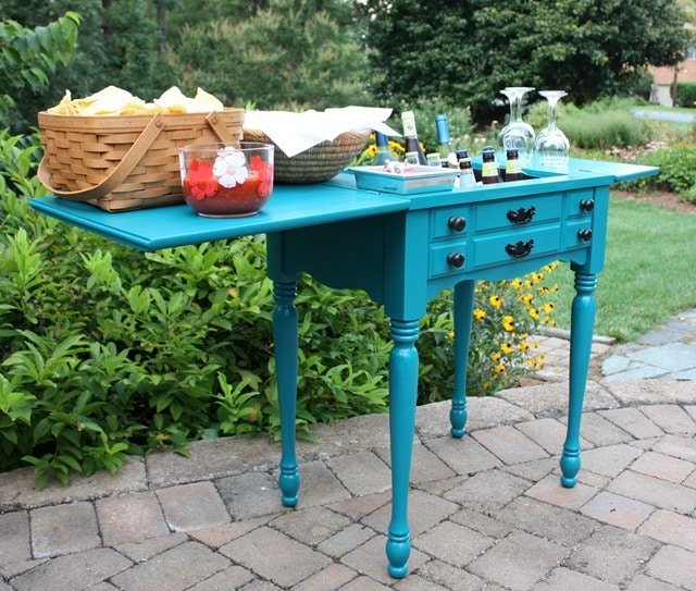 Virginia Sweet Pea sewing table turned outdoor bar in teal color
