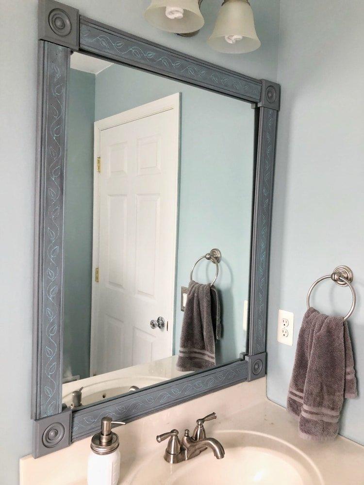 DIY mirror frame in bathroom
