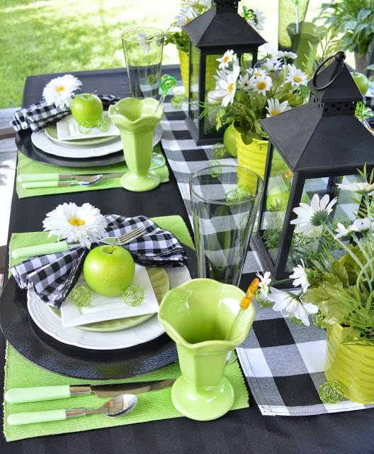 Green and black buffalo plaid tablescape decor from Dining Delight