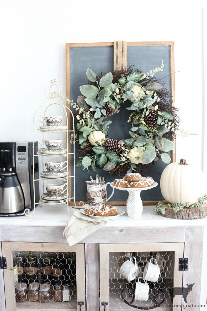 The Crowned Goat farmhouse hutch decorated for fall with rustic wreath