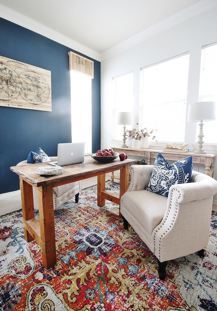Home office reveal with blue accent wall and colorful palette