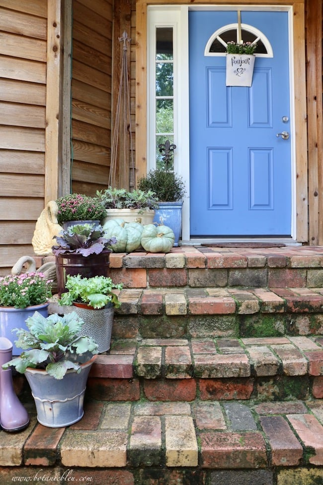 Front porch with fall decor and blue front door by Botanic Bleu