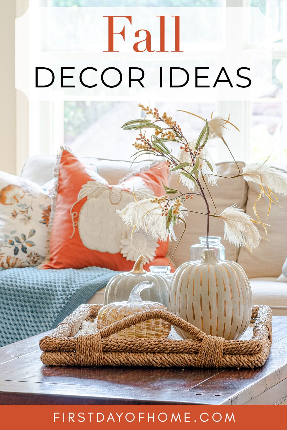 """Pinterest image with coffee table centerpiece with pumpkins on woven tray. Text overlay reads """"Fall Decor Ideas"""""""