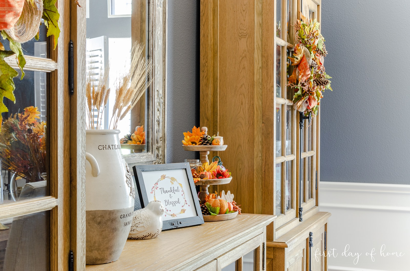 Formal dining room fall decor with rustic fall wreaths and tiered tray decor