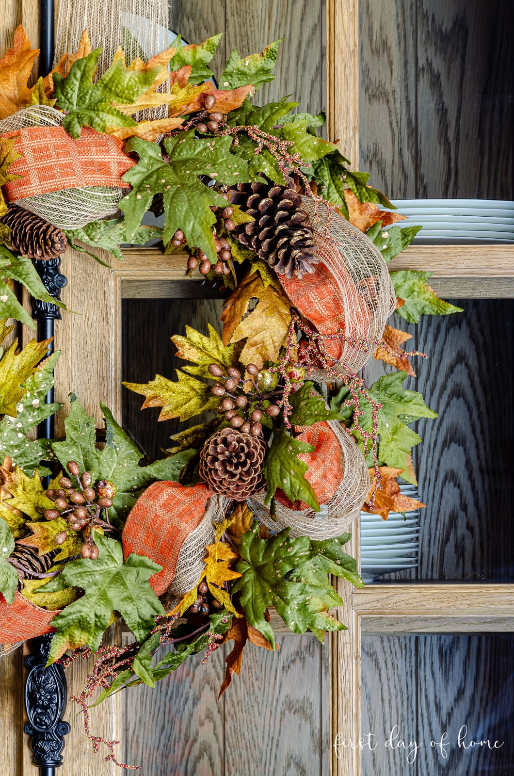 Fall home tour with wreaths on cabinet in dining room