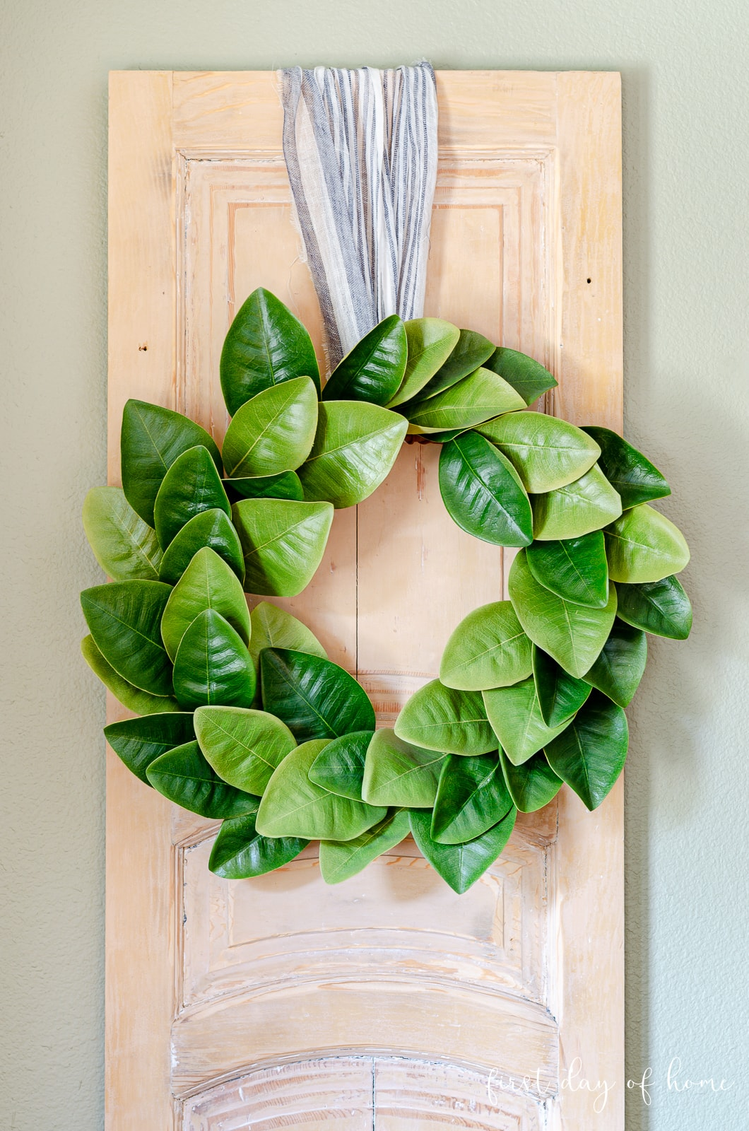 Fall home tour of breakfast room with magnolia wreath on reclaimed wooden door